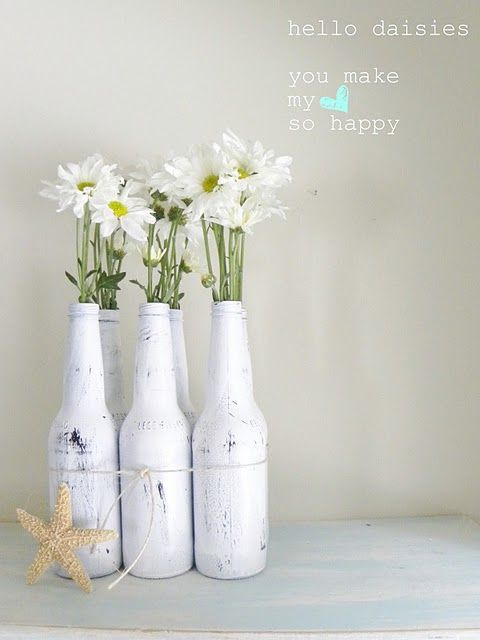 Beer bottle vases - pretty and so simple! It's a sacrifice to drink all that beer, but I'd be prepared to for the sole purpose of this project ;-p