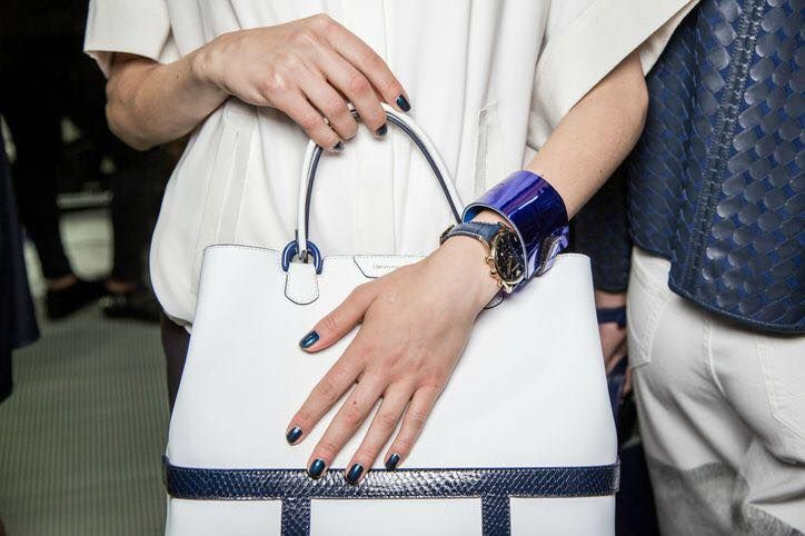 In case this spell of warm weather isn't doing the trick, we're here to feed your spring fever with some fun shots our backstage photographer took of pretty nails and gorgeous designer handbags from the spring 2015 runways. Which combo would YOU most love to wear this spring?