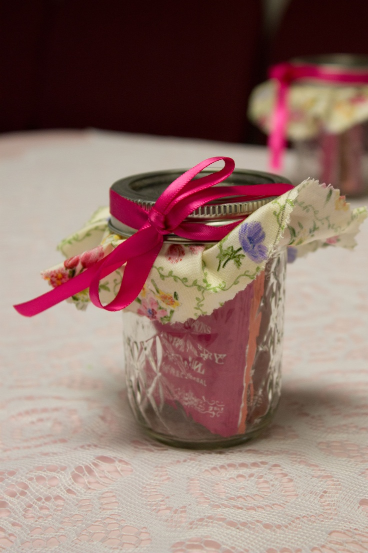 Tea party favor. Mason jar filled with packets of different kinds of tea