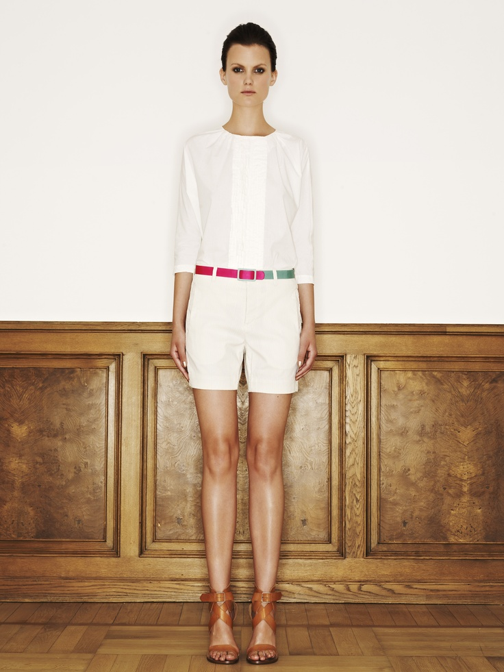 Rützou cotton shirt with short ruffles in off white, silk belt in colour blocking powder rose and cotton nylon spandex shorts in dust brown stribes