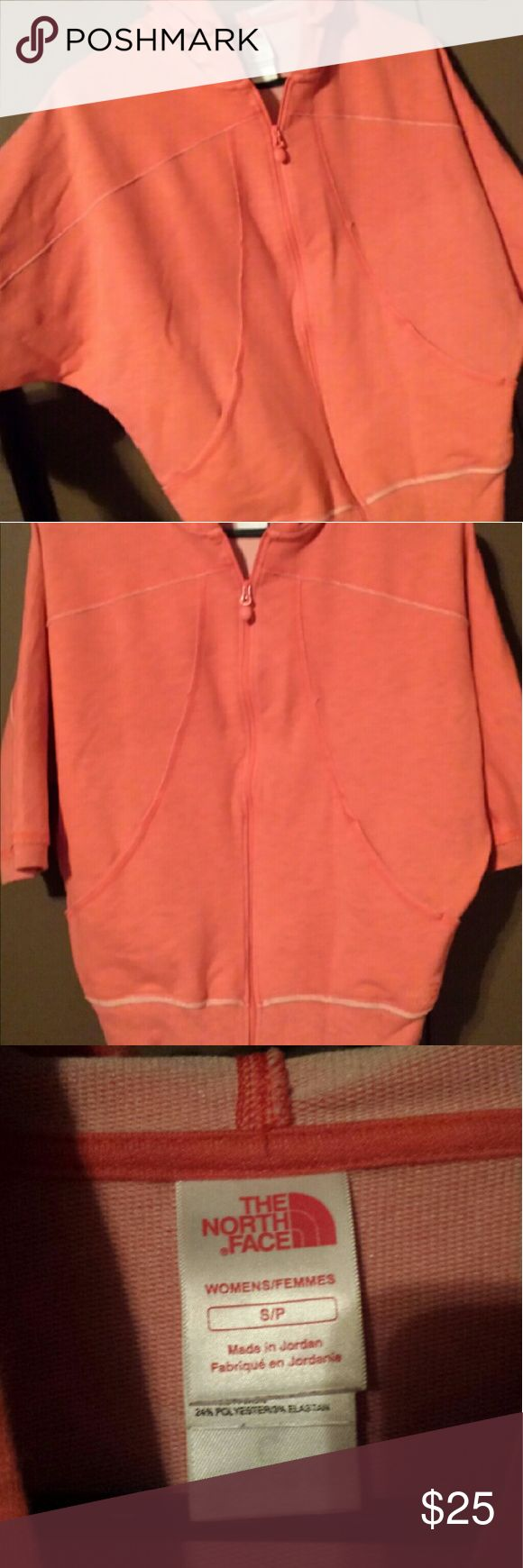 North Face sz. Small zip up hoodie with 3/4 sleeve Like new women's north face 3/4 sleeve full zip hoodie. Loose fitting. Sits above waist. Orange/peach color North Face Tops Sweatshirts & Hoodies