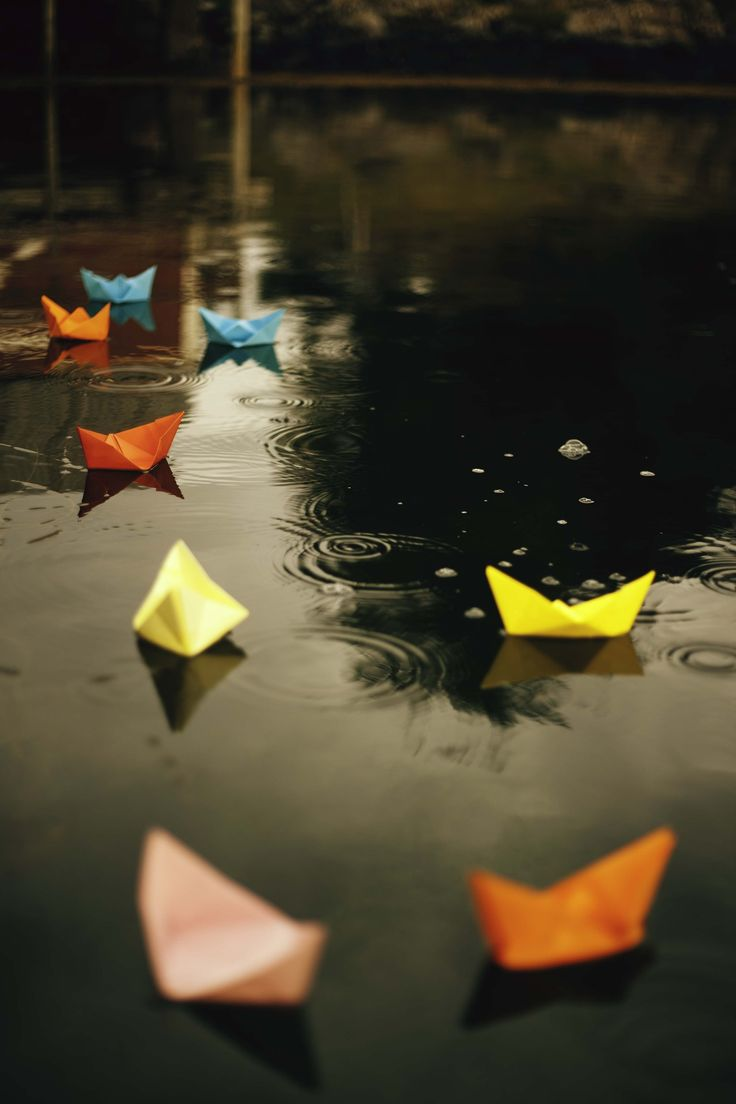 """Ever since I can remember, Mom and I have made little paper boats and set them in the ditch near our home just so we could watch them float away."":"