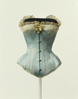 "(via Detail of collections 1870s-1880s | KCI Digital Archives) This corset is a vivid reminder of the painting, ""Nana,"" by Edouard Manet (1832–1883). The center-front busk and bones mold the curve from the waist to the abdomen, while neatly arranging the lower abdomen, as well. Women used corsets in an effort to get closer to an ideal physical form of the time; until the beginning of the 20th century, their waists were tightened by the corset. With the development of modern ..."