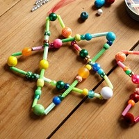 Made with straws, beads, and pipe cleaners! Cute homemade ornament.