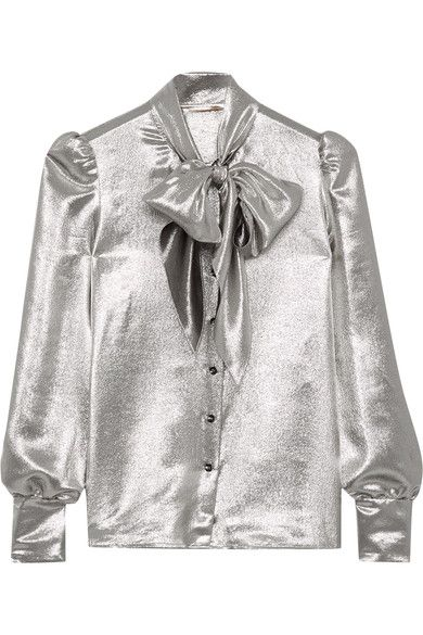 Saint Laurent's blouse embodies its signature high-octane glamour. It's cut from liquid silver silk-blend lamé with '80s-inspired pussy-bow ties that can be left undone for a more relaxed look. An effortless party piece, wear yours with everything from tailored pants to thigh-skimming mini skirts.