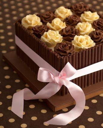 'Chocolate Box' birthday cake  : Chocolate fudge cake, Amedei Toscano    chocolate and orange zest, buttercream, Satab ribbon, milk   chocolate curls, handmade chocolate roses