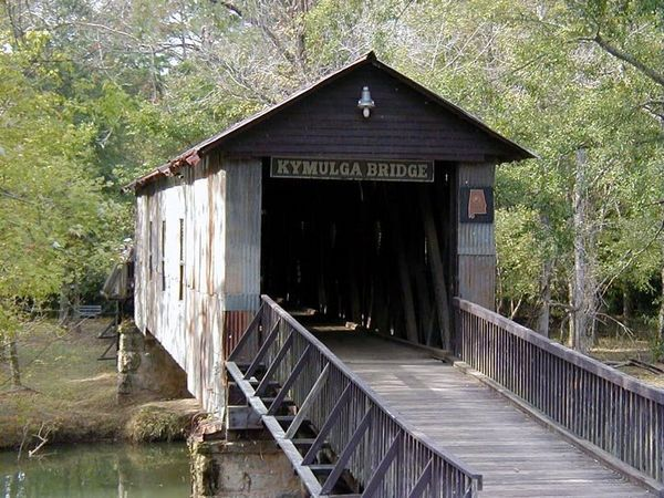 Kymulga bridge in Childersburg in Talladega County  A 105 foot span built in 1861 over Talladega Creek  Restored in 1974 along with the Kymulga Park grist mill