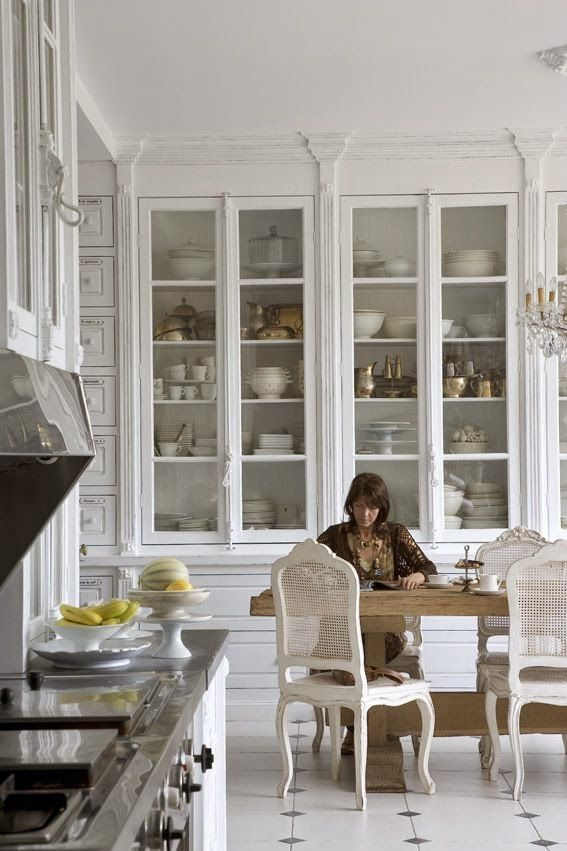 white kitchen tall floor to ceiling glass door cabinets