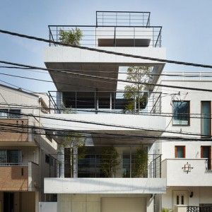 Four-storey+house+with+tree-lined+balconies++by+Ryo+Matsui+Architects