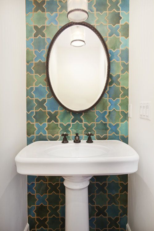green and blue tile design statement wall featured in this powder room erin hedrick design