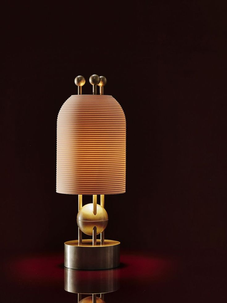 The slip-cast porcelain forms of the lantern series float along a rigid brass structure. Their glow is punctuated by finely incised fluting, connecting to the most essential element of historical lanterns - light passing through a delicate protective form. Repeating spheres act as a counterpoint to the sizeable shades.