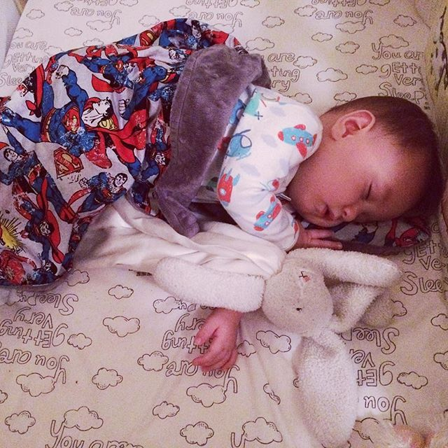 Even super babies need their soft and cuddly sidekicks! Levi all tucked in for the night with his @levi_and_evelyn Man of Steel minky blanket. Dream big dreams lil one..... xo