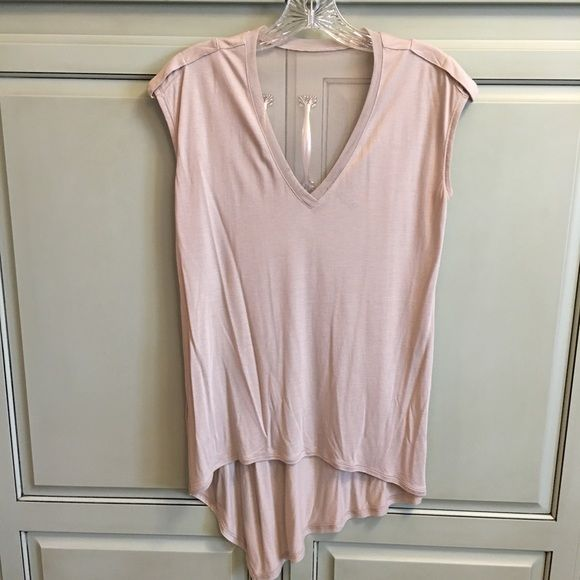 BCBGmaxazria top BCBGmaxAzria sleeveless top. Fits very loose, why listed as small although the tag says xxs. I am typically a s-m depending on brand and fit. Love the asymmetrical cut on bottom and sheerness around top. 100% Modal. BCBGMaxAzria Tops