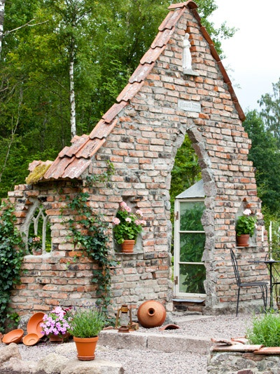 Broken down brick house used as a greenhouse