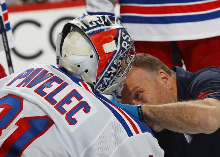 PHILADELPHIA, PA - SEPTEMBER 26: New York Rangers head athletic trainer Jim Ramsay checks out Ondrej Pavelec #31 during the second period during a preseason game at the Wells Fargo Center on September 26, 2017 in Philadelphia, Pennsylvania. (Photo by Bruce Bennett/Getty Images)