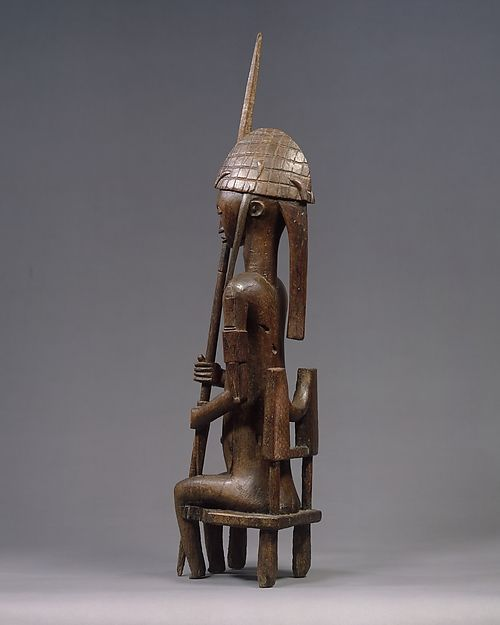"Bamana figures such as this were the focal point of celebrations of the ""Jo"" and ""Gwan"" initiation societies (associations of men and women) in several villages in southern Mali. This work depicts an idealized male leader that would have been the companion to a similarly attired mother and child representation"
