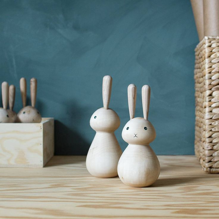Handturned wooden rabbits.