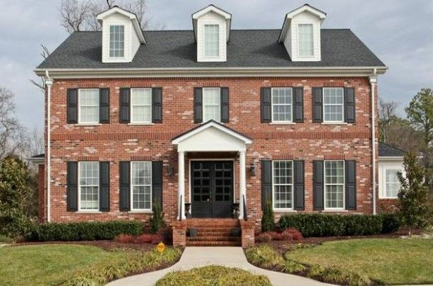 Red brick colonial house exterior thinking a black door is for Brick colonial house plans