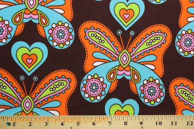 Wonderfly is GOTS Certified Organic Cotton Jersey Knit Fabric with a colorful pattern for children. Buy Wonderfly Organic Jersey Fabrics at Funny Fabrics.