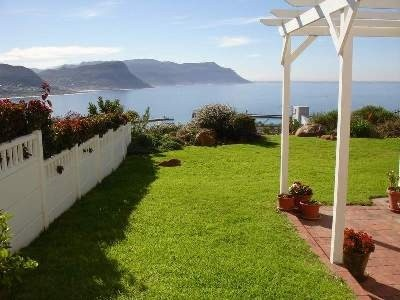 Enjoying uninterrupted False Bay views, this home boasts 3 bedrooms, 2.5 bathrooms plus spacious open-plan living which leads onto a sheltered patio. Double automated garage and a small, manageable garden