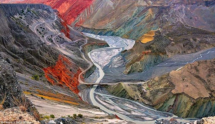 Colourful: Stunning variations in the colour of the landscape makes Hongshan Great Canyon (above) looks as though it has been painted