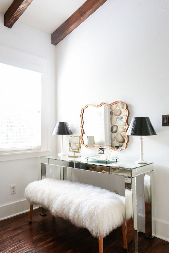 "This is a favorite moment of Kristen's: ""The vanity in the bedroom is so lovely. I have never designed something like this before. I love the mix of metals and and the Mongolian fur bench... so glam!"""