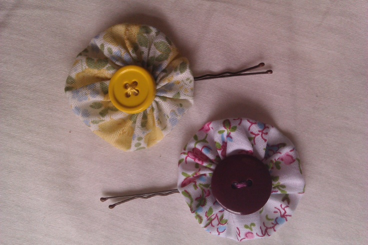 Fabric flowers on hair pins.
