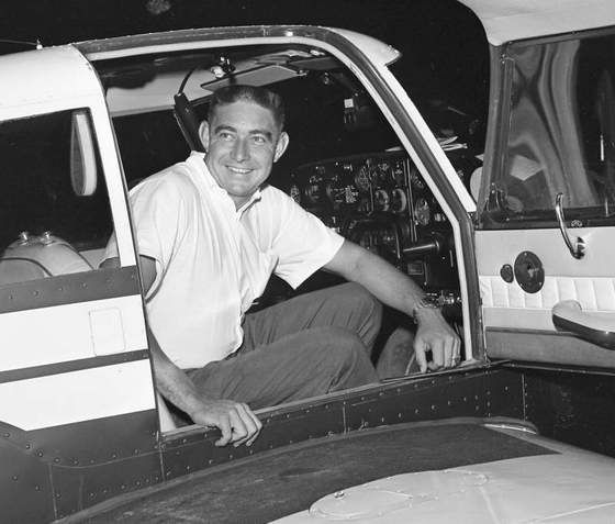 """Glenn """"Fireball"""" Roberts exits his private plane in Nashville to compete in the super stock drag  meet at Union Hill, a track near Goodlettsville. Roberts had been signed to replace Fred Lorenzen,  who couldn't make it. (J.T. Phillips / The Tennessean) 9/7/1963"""