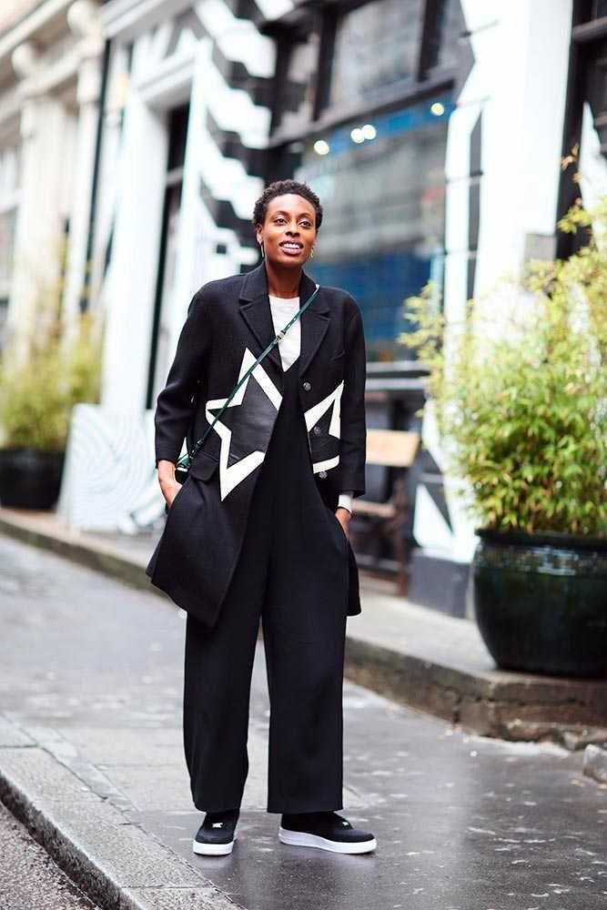 Donna Wallace, Accessories Editor Neill Barrett star print coat, AllSaints jumper, Joseph black jumpsuit, Office trainers, Eddie borgo green bag. What ELLE Wears, LFW SS 2016 Street Style.