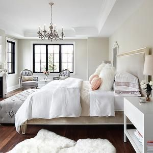 The Design Company - bedrooms - modern french bedrooms, french bedroom, blush pink bed, white and pink bedding, sheepskin pillows, white she...