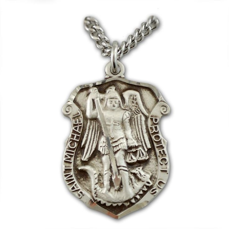 The Archangel Michael is the patron of all those in temptation, the sick and dying, policemen, sailors, those in peril at sea, paratroopers, those in battle, and cemeteries. St. Michael's feast day is September 29th. This 1 inch tall sterling medal in the shape of a police officer's badge is designed especially for law enforcement. The front of the medal depicts the image of St. Michael and has 'St. Michael Protect Us' engraved on it while the back of the medal is blank allowing for…
