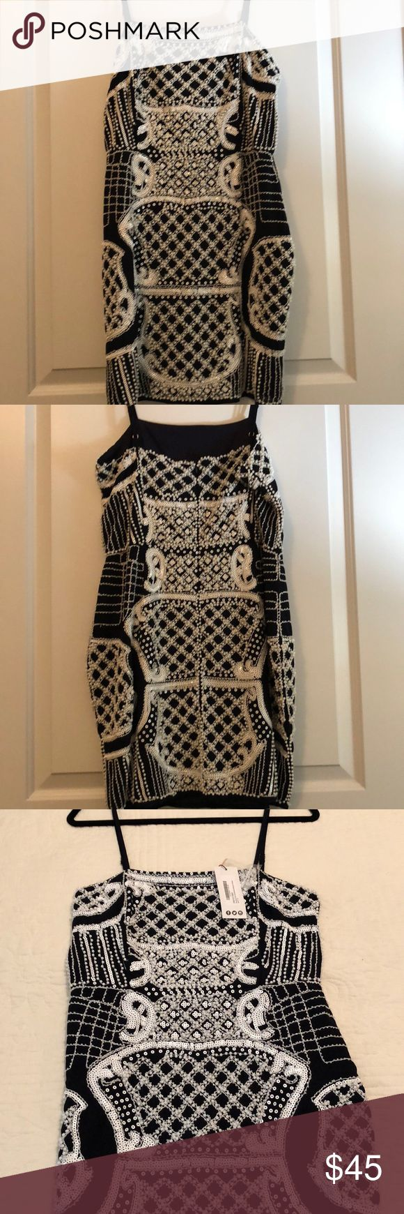 NWT Embellished Dress Very dark, navy blue with white sequins and beading. Beautiful dress. Heavy fabric. Fully lined. Gorgeous on! Dresses Mini