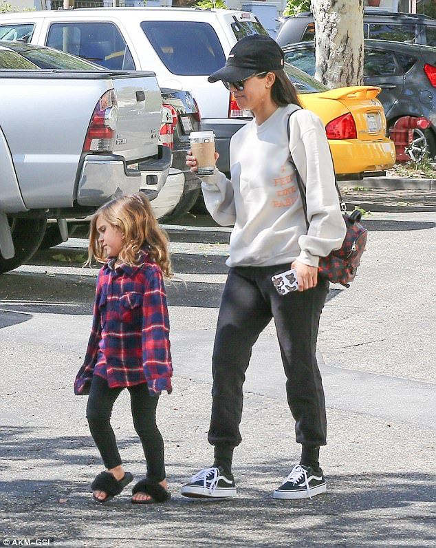 Low key: Mom Kourtney was also making sure to represent her creative family member, Kanye, by wearing a sweater from his collection with black tracksuit pants