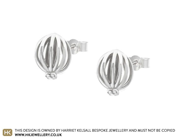 The 3D structure of these palladium earrings is inspired by the humble seed pod. Beading detail at the base of each earring creates an organic shape and one which mimics the appearance of a poppy seed pod. Each earring is approximately 12mm in height, 9mm in width and 5mm in depth. A polished finish completes these striking earrings. The scrolls of these earrings are 9ct white gold, which has been rhodium plated to match the brighter white look of the palladium.