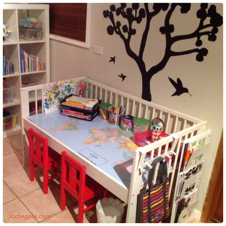 I upcycled the kids' old cot into a desk using IKEA cot and other items from IKEA. Upcycled cot. Upcycled crib. Children's homework. Homework organization. Homework table. Creative table. Instructions on IKEA Hackers: http://www.ikeahackers.net/2013/10/kids-artcrafthomework-table-from-ikea-gulliver-cot.html
