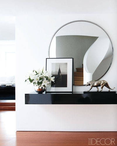 picture frame standing against mirror