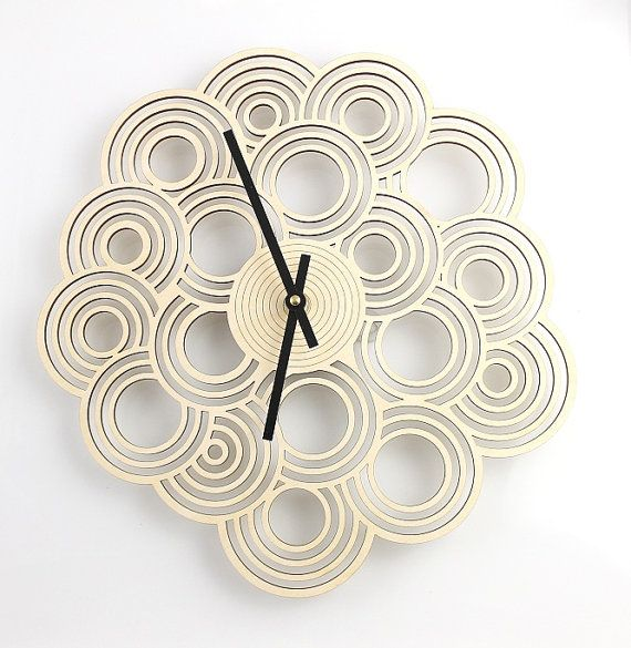 Want!  https://www.etsy.com/listing/188313862/intergrated-circle-design-clock-modern