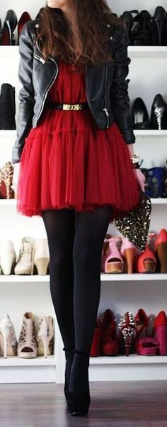 Red tulle dress, with brown small belt, black stockings, black heels, and black leather jacket