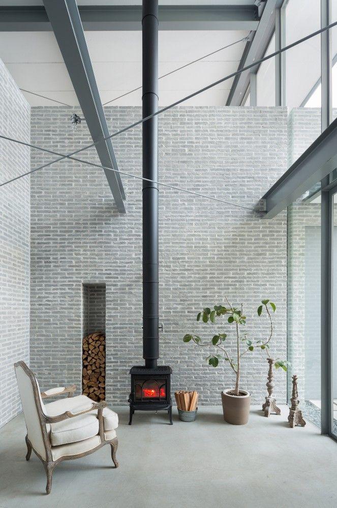 House in Sakurashinmachi / Comma Design #fireplace