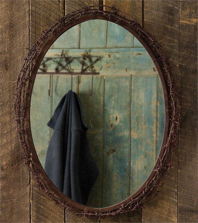 """The perfect addition to any country home. This western inspired mirror features a barbed wire detail around the mirror. Dimensions: 26""""H x 20.5""""W x 2.75""""D Material: Iron & Glass"""
