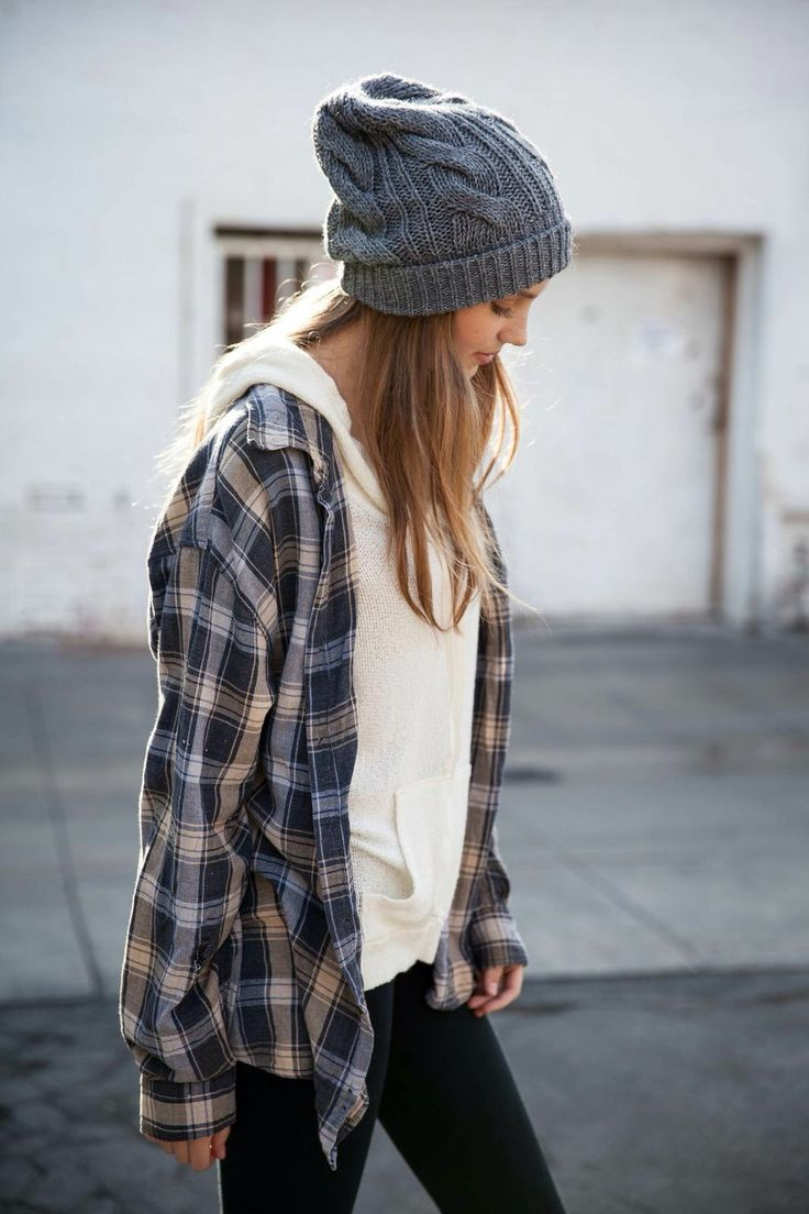 Grey beanie, blue & white plaid, white/cream sweater, leggings.
