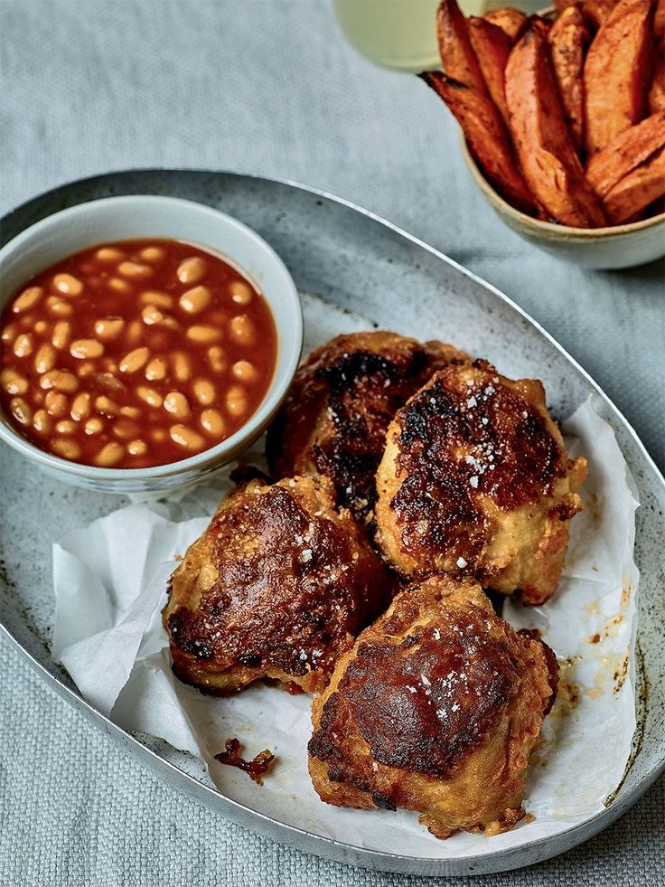 This recipe for Crispy Chicken with Sweet Potato Fries and Beans by Nadiya Hussain, from Nadiya's British Food Adventure on BBC2, is a delicious take on chicken and chips.