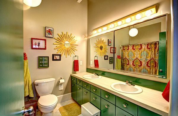 Make the space feel inviting and comfortable by putting up some framed photos30 Playful And Colorful Kids' Bathroom Design Ideas