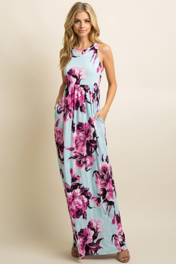 e0b23f34fc9 A floral print sleeveless maxi dress featuring a rounded neckline