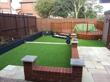 Artificial grass used to create a 2 tier lawn in this for Big back garden designs
