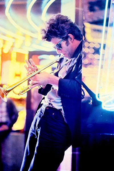 "Tom Waits in a scene from Francis Ford Coppola's   One from the Heart (1982) where neon ""saturates the air of Las Vegas with sensation"""