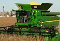 John Deere combine. 400-bushel grain tanks.