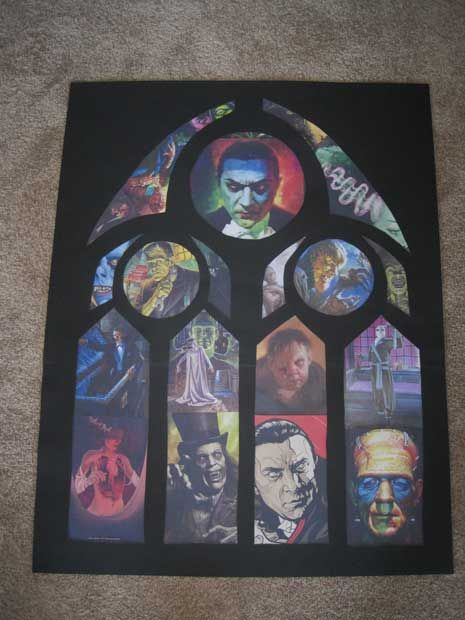 """Make your own """"stained glass"""" using cool pictures instead of tissue paper.  This is black poster board sized to your window.  Cut out a gothic design.  Then cut pictures you like to size.  These will be back lit so the colors pop.  Examples of how this was made on Halloween Forum"""