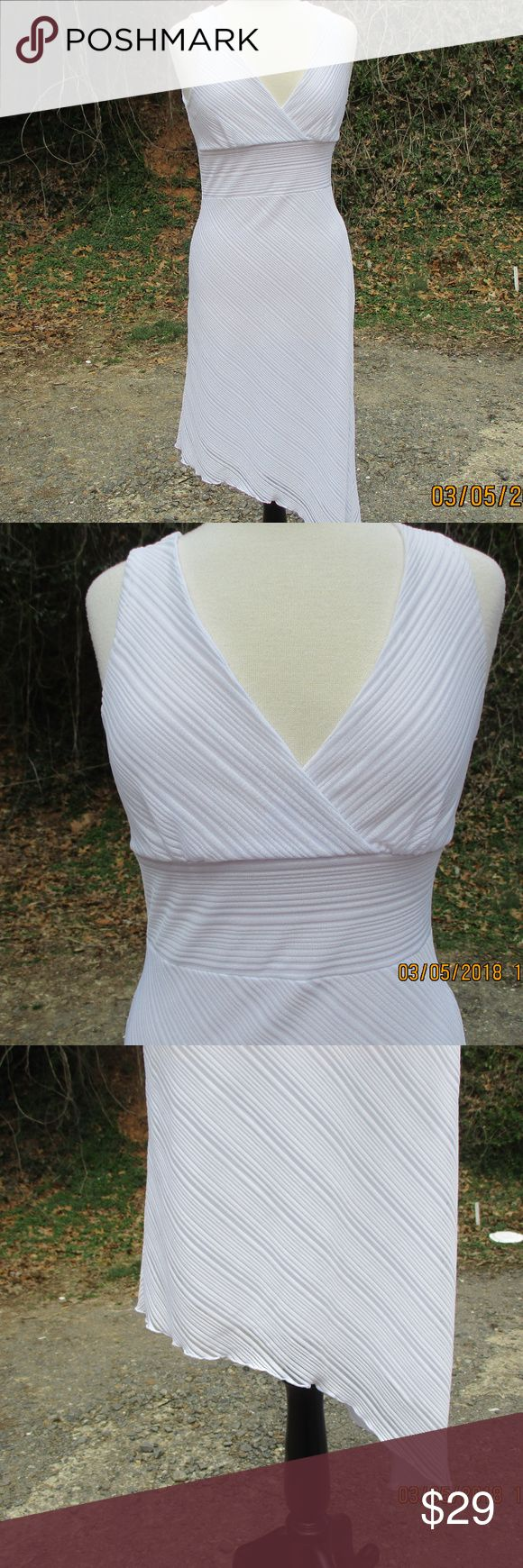 """Charlotte Russe White Stretchy Dress Party Career Charlotte Russe White Stretchy Dress Party Career Size Large Asymmetrical Hem Crossover Wide Waistband Sleeveless Fully Lined No zippers, buttons or pockets. 98% Polyester 4% Spandex Hand wash or dry clean Pit to Pit 17.5"""" Waist 15"""" Hips 18"""" Length 43""""  ALL MEASUREMENTS ARE TAKEN WITH ITEM LAID FLAT,  UNSTRETCHED, AND ARE APPROXIMATES Charlotte Russe Dresses"""
