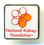 """A best seller! This good looking ¾"""" square National Kidney Foundation logo pin has a bright white face with gold color trim. Stands out in the crowd."""